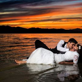Sunset Kiss on the Lake by David Terry - Wedding Bride & Groom ( water, colorful, sunset, lake )