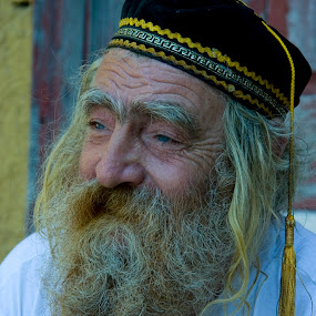 Old man in Greece by Gale Perry - People Portraits of Men ( cap with tassle, old, colorful background, greece, gold and grey beard, man,  )