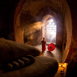 Buddhist novice praying by Ron T - Buildings & Architecture Places of Worship ( monk, pagoda, window light, buddhist, landscape, burma, buddhist novice, temple, myanmar, myanma, praying, window lighting, culture )