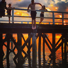 Jump by Ann Goldman - Novices Only Sports ( jump water pier kids sunset )