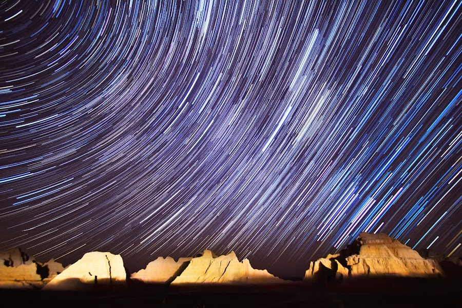 Badlands Spin II by Evan Ludes - Landscapes Starscapes ( star, south dakota, astronomy, national park, mountains, stars, trail, star trail, astrophotography, night, trails, badlands, starry )