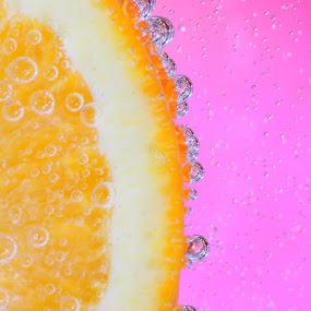 Orange on pink by Ruth Jolly - Food & Drink Fruits & Vegetables ( orange, fruit, macro, citrus, still life, food, bubbles, orange and pink, , Food & Beverage, meal, Eat & Drink )