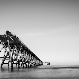 Steetley Pier  by John Haswell - Buildings & Architecture Bridges & Suspended Structures ( sea defence, pier, seascape, b&w, contrast, minimalist, black and white, landscape, structure )