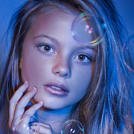 Bubbles by Carel Van Vuuren - Babies & Children Child Portraits ( child, face, girl, blue, blond, bubbles, hair, portrait, eyes )