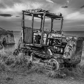 Coastal Worker by Darrell Evans - Transportation Other ( clouds, old, grass, engine, vintage, green, ruin, oxidation, vehicle, agriculture, equipment, tracks, parked, farming, coast, neglected, track marshall, industrial, bulldozer, transport, outdoor, meatal, rust, tractor, abandoned )