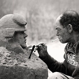 Sculptor by Leyla Dwelle - People Street & Candids ( creation, sand, oregon, black and white, art, carving, ocean, beach, artwork, sculpture, utinsil, oregon coast, artist, nikon, sculptor, natural, man )