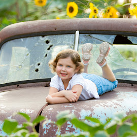 Brit on Old Truck by R Jay Prusik - Babies & Children Child Portraits ( child, knoxville, ut gardens, sunflower, rustic, old truck,  )