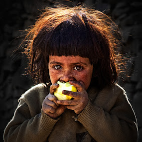 Hungry by Nayyer Reza - Babies & Children Children Candids ( hunger, girl, color, apple, nayyer, reza, Emotion, portrait, human, people,  )