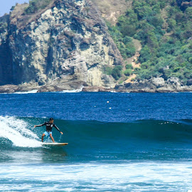 Surf on Wediombo Beach by Tofik Rozaq - Sports & Fitness Surfing