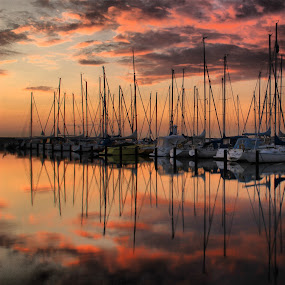 into the pink by Julija Moroza Broberg - Transportation Boats ( clouds, reflection, sky, sunset, boats, pink, formation, yachts )