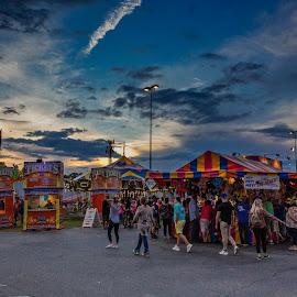 Fair Sunset by Teresa Solesbee - City,  Street & Park  Amusement Parks ( funnel cakes, storm clouds, fair, rides, people, amusement )