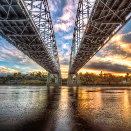 Twin Bridges by Bob Crow - Buildings & Architecture Bridges & Suspended Structures ( clouds, sunset, bridge, jefferson city, missouri river )
