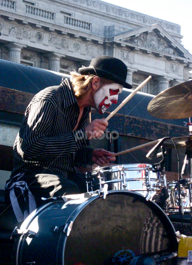 The Drummer by Venetia Featherstone-Witty - People Musicians & Entertainers ( san francisco love parade, painted drummer, drummer, musician, drums, clown face,  )