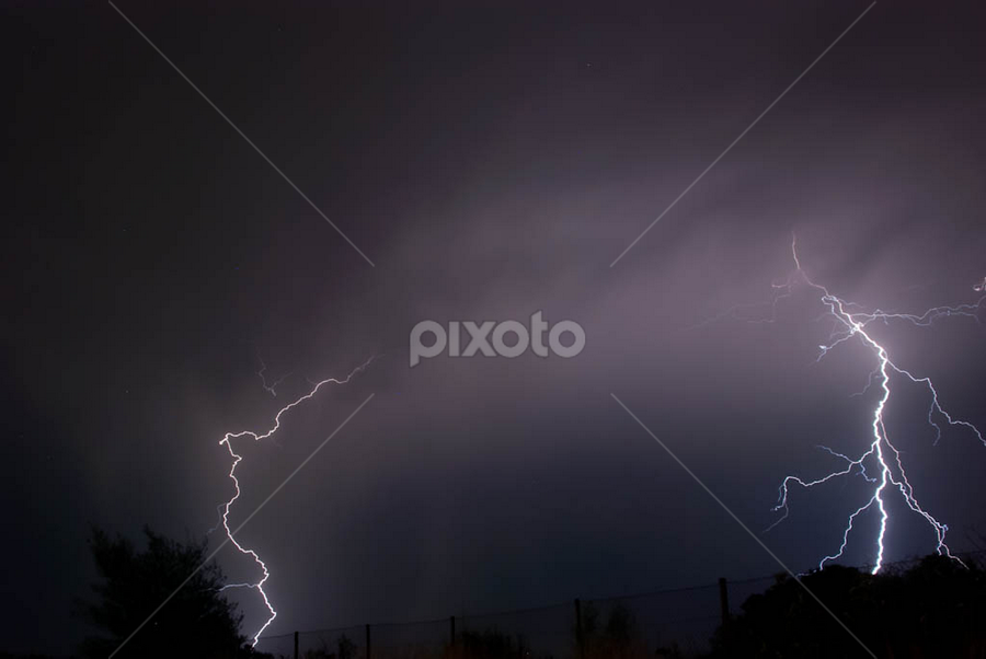 Twin Strikes by Marc Rossmann - Landscapes Weather ( flash, rossmann, bolt, bright, ground, greeting cards, landscape, storm, photomarc, strike, phenomena, sky, nature, weather, power, electricity, electrostatic, elements, rain, black, thunder, clouds, thunderstorm, chasing, white, lightning, blue, night, energy )
