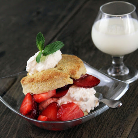 Old Fashioned sweet cream biscuits topped with whipped cream and strawberries tossed in sugared Grand Marnier sauce...