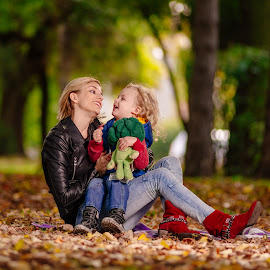 Mother's love by Bugarin Dejan - People Family ( love, park, mother, autumn, colors, family, outdoor, son, smile, portrait, eyes )
