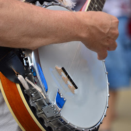 Strum by Thomas Shaw - People Musicians & Entertainers ( music, strap, musical, neck, silver, strings, the works, raleigh, north carolina, band, fourth of july, fingers, musician, arm, group, banjo )