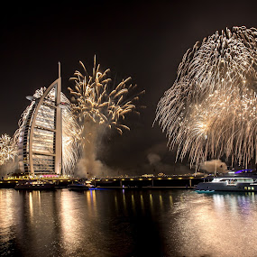 Dubai welcomes 2016 by Jaideep Abraham - Public Holidays New Year's Eve ( reflection, dubai, jumeirah, uae, lightpainting, burj al arab, sea, fireworks, new years eve )