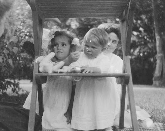 Around the turn of the last century, the box camera was developed and photography became easier, but there were still few individuals who owned a camera. Wilhelm von Geijer, husband of Irma, was a keen amateur photographer and captured many moments of their lives. This is Irma, 38 years, playing with her children Margit and Erik.