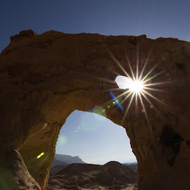Breaking sunlight by Amir Ehrlich - Landscapes Caves & Formations ( desert, rock formation, sunlight, flare, rocks, sun, rays )