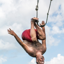 Head over heels by Joe Saladino - Sports & Fitness Watersports ( rope, somersault, swing, pond, swimmer )