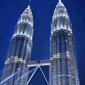 At Petronas Tower by Irshad Rahimbux - Buildings & Architecture Office Buildings & Hotels ( building, tower, blue sky, blue hour, petronas, malaysia, light, #Gautam buddha  )