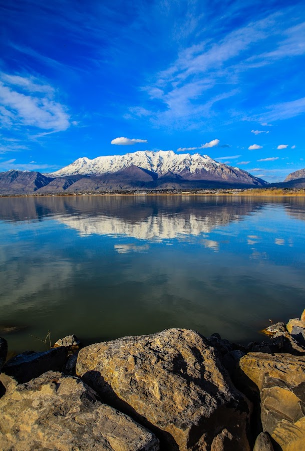 Utah Lake and the Mountain by Alexander Marinenko - Landscapes Mountains & Hills ( clouds, shore, water, seashore, waterside, lake, landscape, coast, skies, mountains, water front, blue, snow, rocks, waterfront, river )