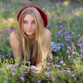 laying in flowers by Lize Hill - People Portraits of Women