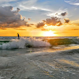 paddle boarder in the surf at sunset by Jeffrey Lee - Landscapes Sunsets & Sunrises