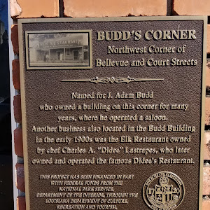 Named for J. Adam Budd who owned a building on this corner for many years, where he operated a saloon. Another business also located in the Budd Bulding in the early 1900s was an Elk Restaurant owned ...