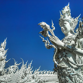 statue by Tonny Haryanto - Buildings & Architecture Statues & Monuments ( building, big statue, thailand, white, architecture, samsung, wat, temple, samsung galaxy note, statue, blue sky, chiang rai, place )