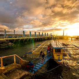 Day In; Day Out by Chin Fei Ng - Transportation Boats ( boat; sunset; jetty; sea; clouds )