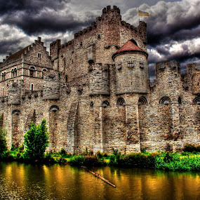 Gravensteen Castle ( Gent, Belgium) by Gianluca Presto - Buildings & Architecture Public & Historical ( water, clouds, europe, gothic, mystery, hdr, gravensteen, historic district, canal, historic, gent, walls, ancient, flag, fortress, legend, dark, gand, cloudy, castle, medieval, river,  )