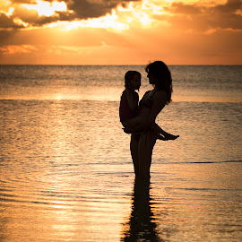 Mermaids by Troy Wheatley - People Family ( child, water, reflection, mother, sunset, silhouettes, mermaid )