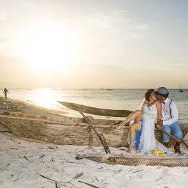 Boat Kiss by Andrew Morgan - Wedding Bride & Groom ( love, kiss, zanzibar, strobist, wedding, sunset, beach )