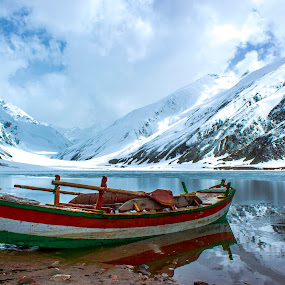 Boat and Reflection by Umair Khan - Landscapes Mountains & Hills ( water, green, beautiful, pwcreflections, pictures, lake, boat, mountains, red, blue, snow, whit, stones, refection, black, peaks, covered,  )