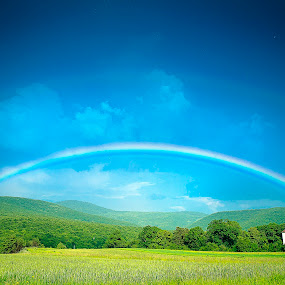 Rainbow on hills by Robert Luca - Landscapes Weather