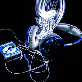 The Music Escaping by Missy Norman - Abstract Light Painting ( music, light painting, 7/3/14, blue, ipod, missynormanphotography, white, skullcandies, escaping, headphones, missy norman, black )