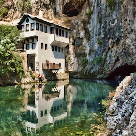 Blagaj (Bosnia Erzegovina) by Gianluca Presto - Buildings & Architecture Homes ( water, home, water reflection, old, reflection, beautiful, stone, reflections, architectural detail, house, architecture, historic, ancient, bosnia, architectural, rocks, river, blagaj,  )