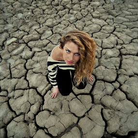Gapes  by Ivana Miletic - People Fine Art ( dried up lake, gapes, view, ivana miletic, a girl, drought )