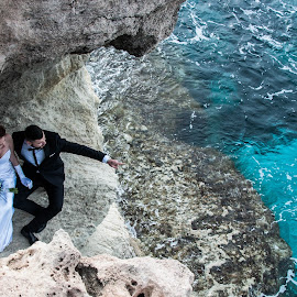 Looking for the future by Daniela Casuneanu - Wedding Bride & Groom ( wedding photography, blue sea, turquoise, blue, future, wedding, sea, pointing, bride and groom, rocks )