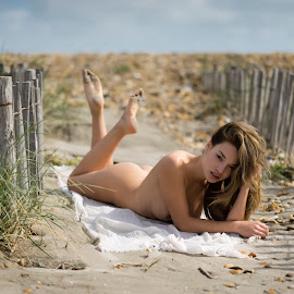 Wild Flowers by Alex Tsarfin - Nudes & Boudoir Artistic Nude ( clouds, look, sand, model, nude, grass, art, beach, beauty, skies, portrait, eyes, pose, female, woman, naked, flowers, hair )