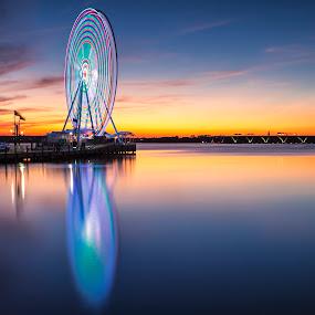 the eye 2 the sky by Edward Kreis - City,  Street & Park  Vistas ( reflection, national harbor, sunset, woodrow wilson bridge, potomac, river, ferris wheel )