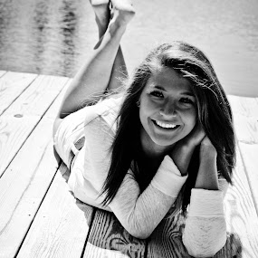 Happy by Alena Purvis - People Portraits of Women ( water, black and white, lake, beauty, cute, portrait, dock, sun, girl, happy, summer, brunette, smile )