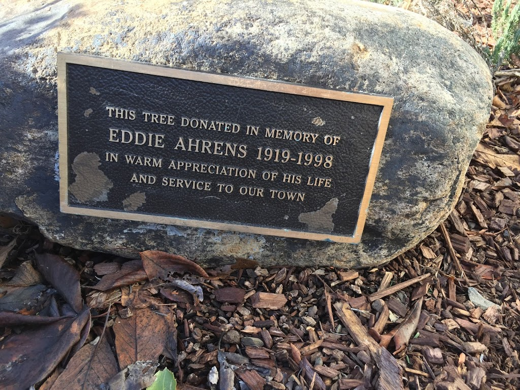 THIS TREE DONATED IN MEMORY OF EDDIE AHRENS 1919-1998 IN WARM APPRECIATION OF HIS LIFE AND SERVICE TO OUR TOWN