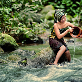 Washing the Urn by Mario Wibowo - People Portraits of Women