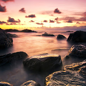 Magic sunset light by Luca Rosacuta - Landscapes Waterscapes ( clouds, purple, sunset, sea, pink, seascape, landscape, rocks )