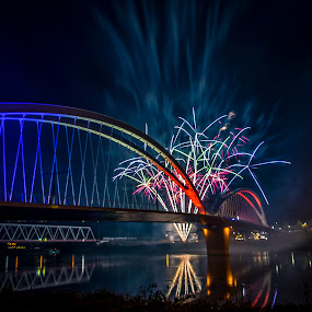 French German friendship by Crinu Topalo - Buildings & Architecture Bridges & Suspended Structures ( lights, water, reflection, fireworks, germany, france, night, bridge )