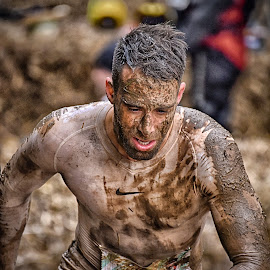 Clenching His Teeth ! by Marco Bertamé - Sports & Fitness Other Sports ( muddy, 1857, mud, differdange, strong, 2015, brown, number, strongmanrun, running, man, luxembourg )
