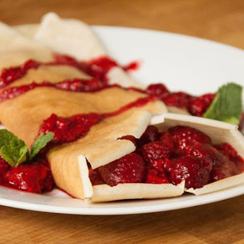 Coconut Crepes with Blood Orange and Raspberry Sauce
